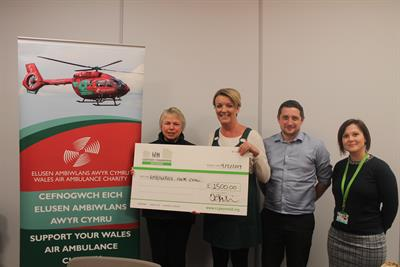 Members of CCG handing over a cheque to Wales air ambulance
