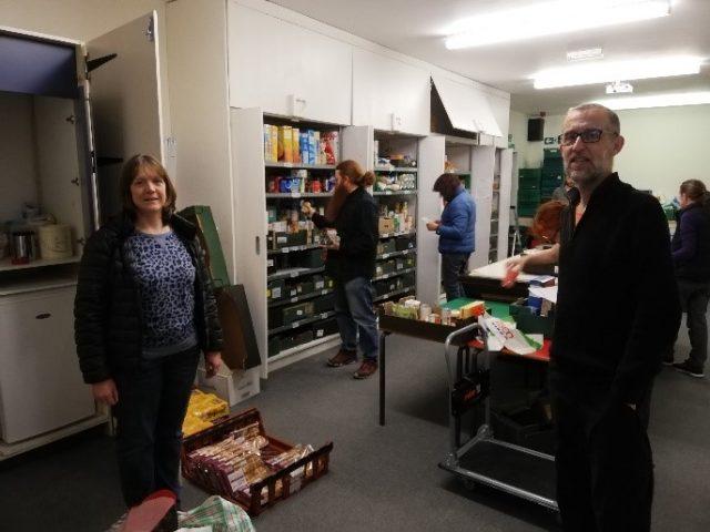 Gwynedd Council staff sorting food at the food bank